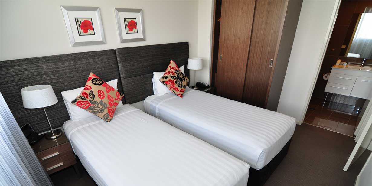 adina-serviced-apartments-canberra-dickson-one-bedroom-room-twin-02-2018-1230x615.jpg